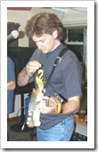 Me playing guitar at a gig, 1999