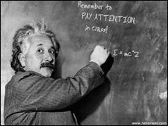 Eistein writing on a blackboard